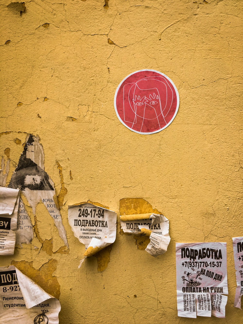 flyers on yellow wall