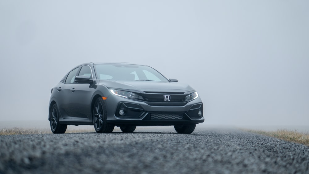 gray Honda sedan parked on road during day
