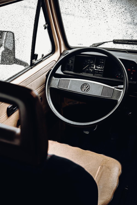 shallow focus photo of black Volkswagen steering wheelk