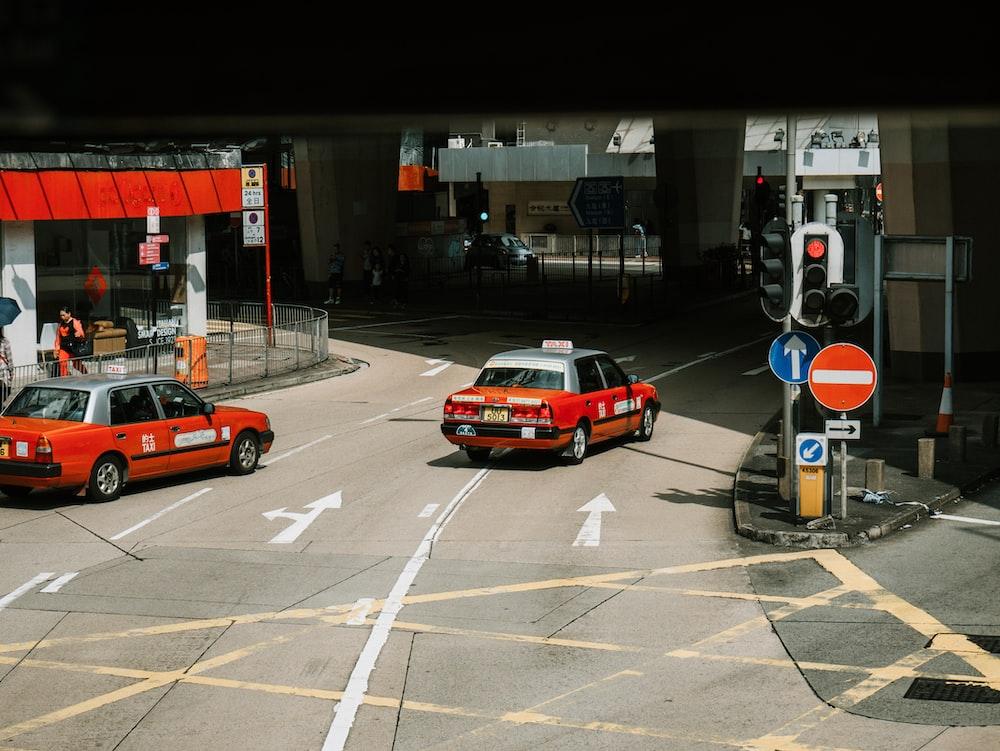 red sedan running near underpass