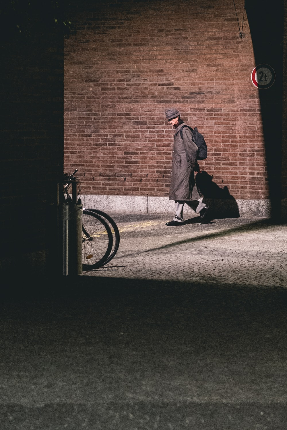 man walking in alley