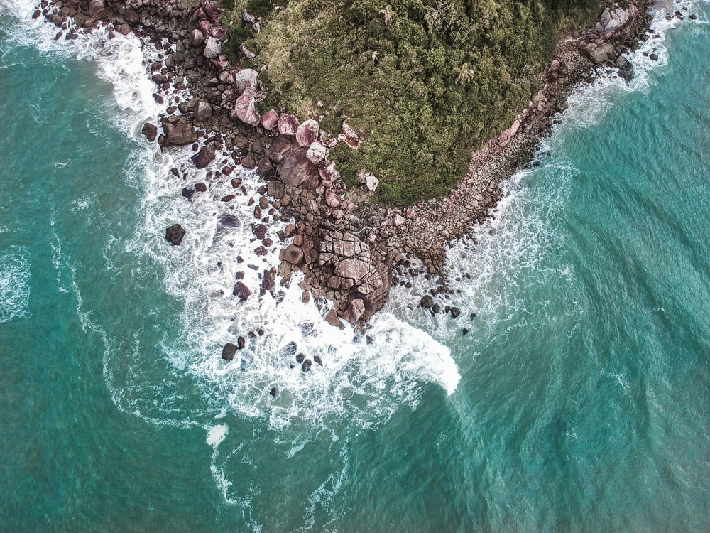 aerial view of rocks on shore