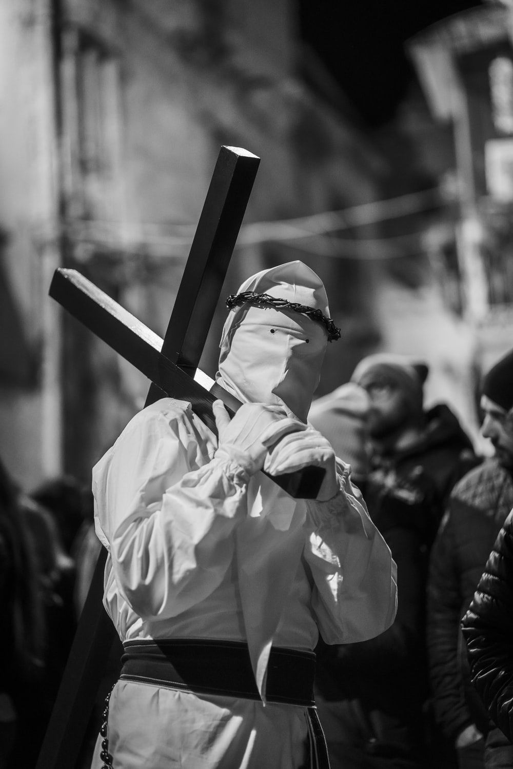 man carrying cross on their shoulder