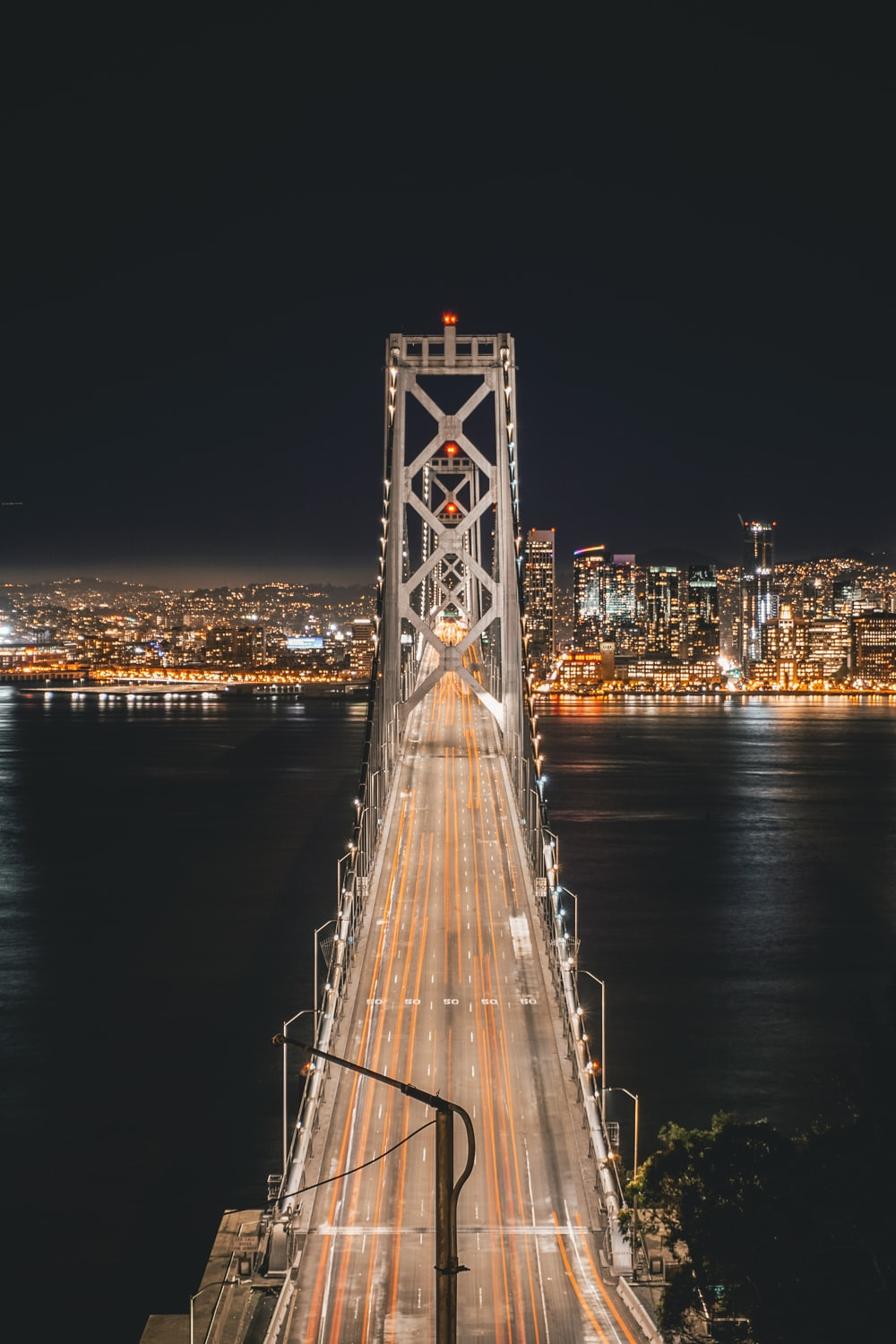 bridge and city during night