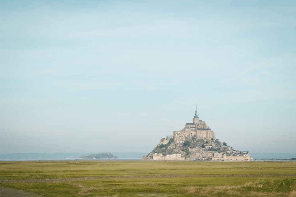 Mont Saint Michel in France under blue and white sky