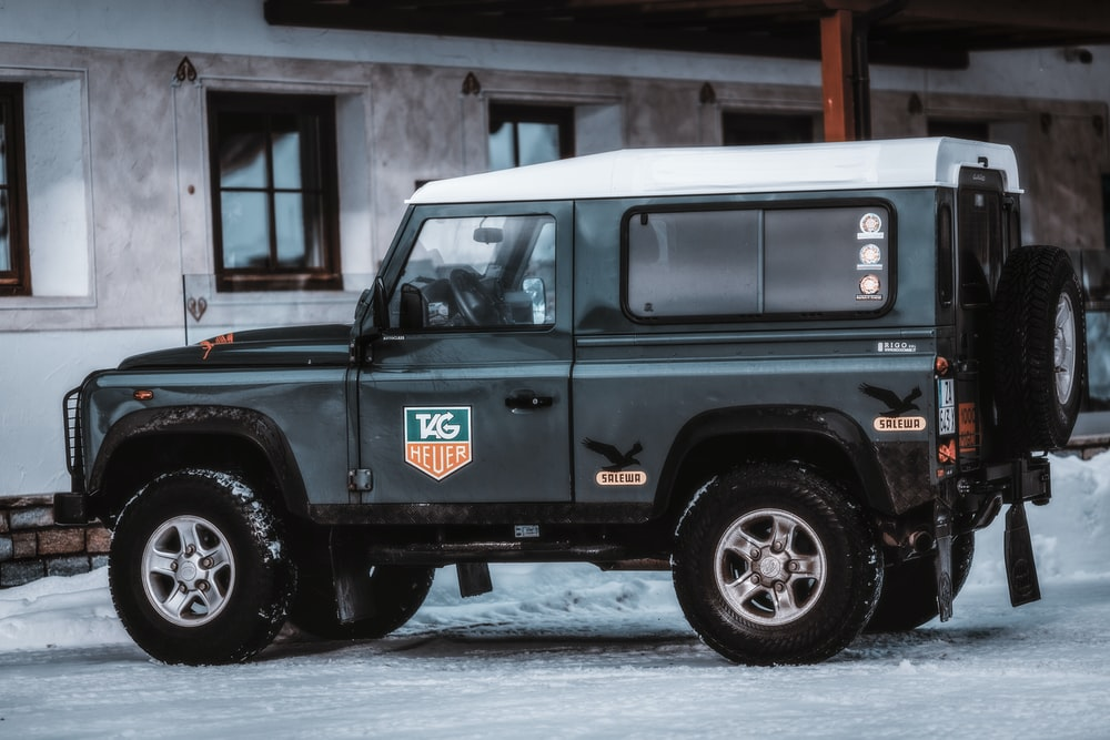 black Jeep Wrangler SUV on snow-covered door
