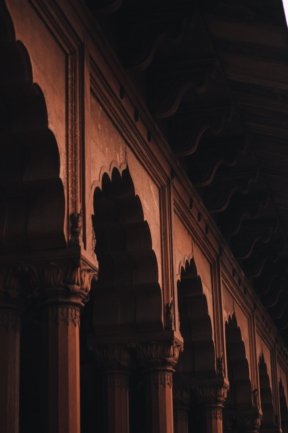 architectural photography of brown column