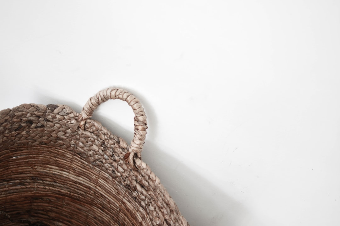 A Woven Basket On A White Background - unsplash