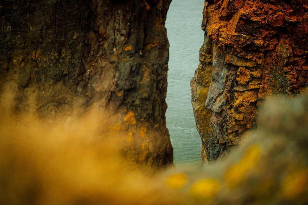 brown coastal cliff during daytime