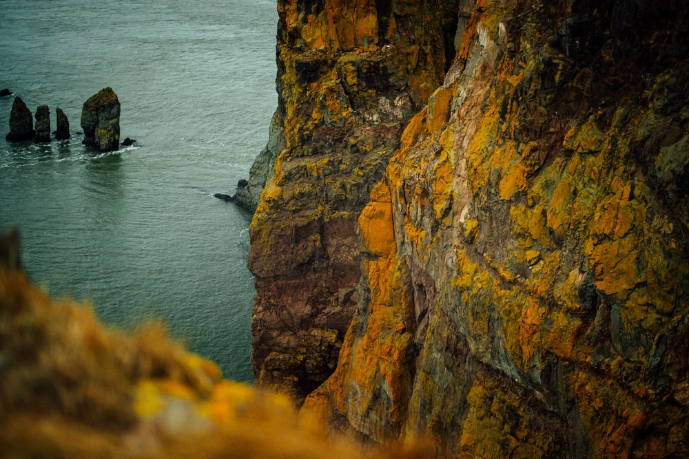 landscape photography of rock formations on body of water during daytime