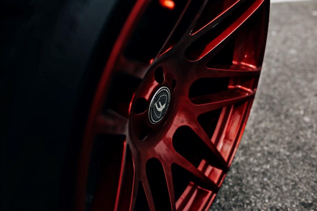 Red Rims On A Wheel - unsplash