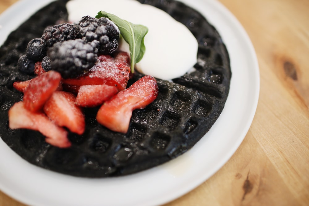 plate of waffle on wooden surface