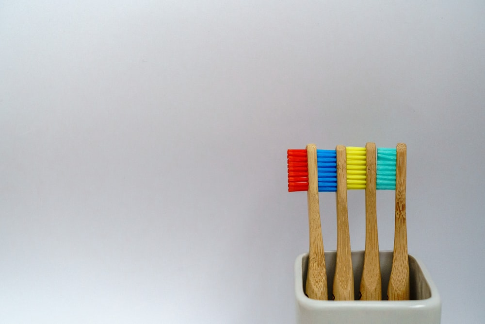 four assorted-color toothbrushes