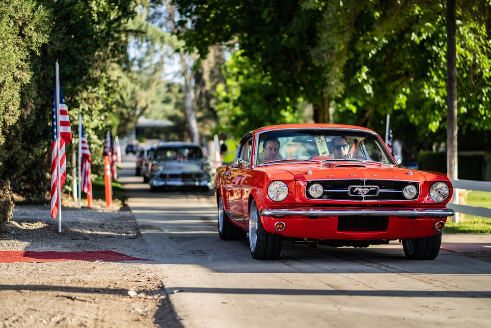 red muscle car on road