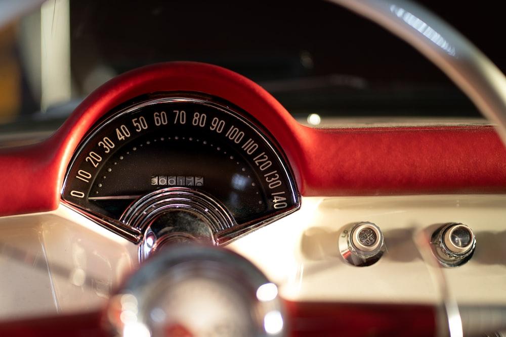 black analog speedometer