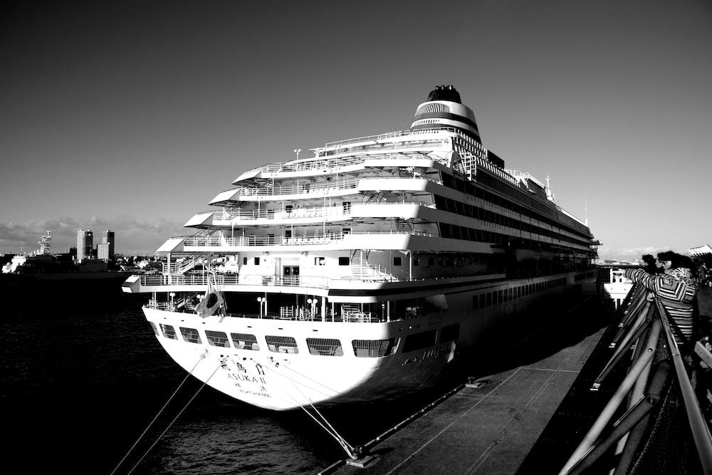 white cruiser ship on port