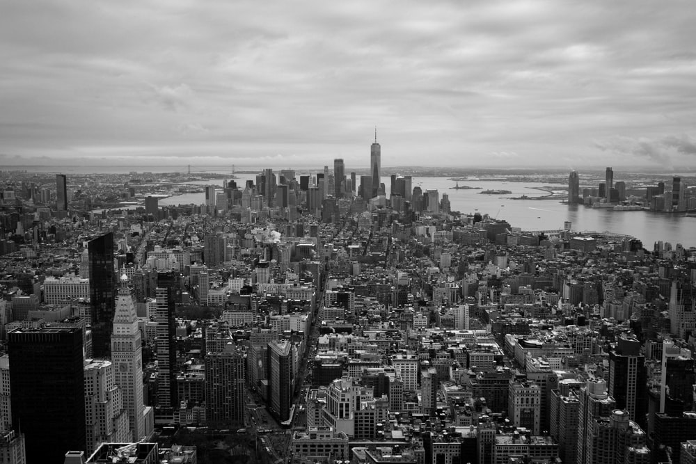 grayscale photography of city high rise buildings