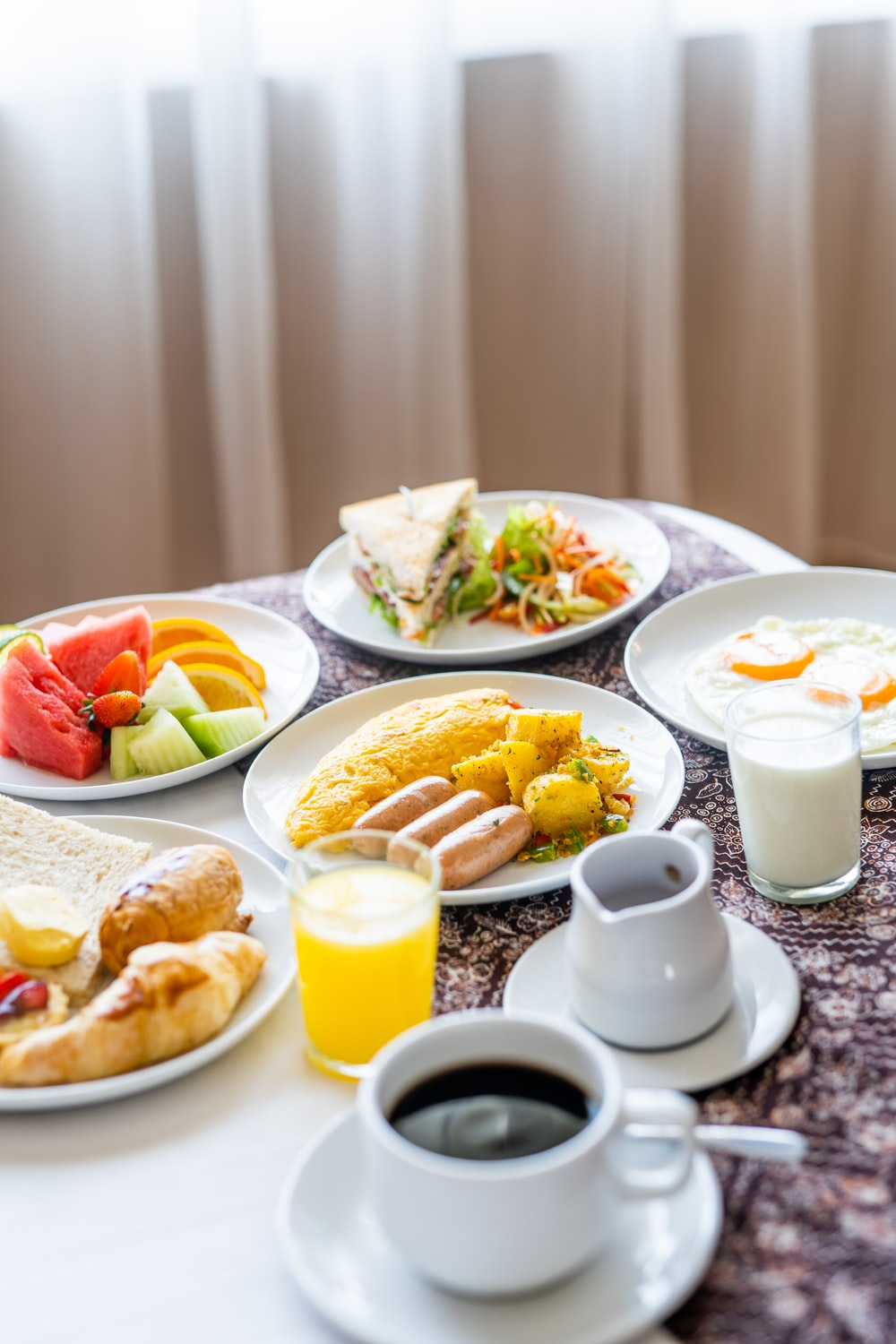 assorted cooked foods and sliced fruits