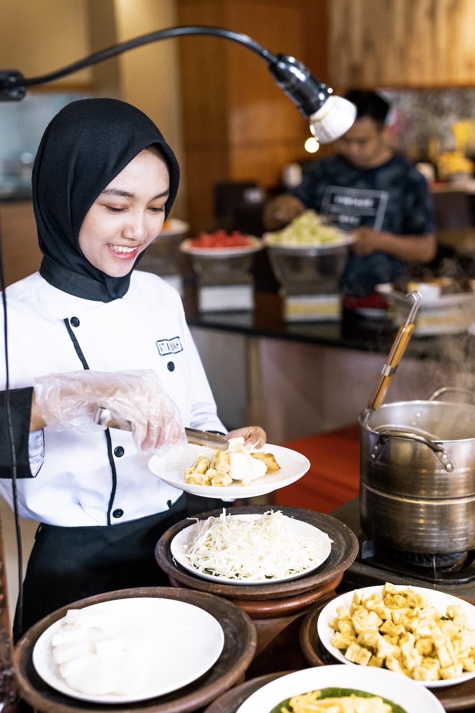 woman getting food inside building