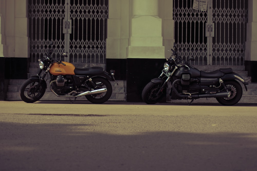 two black and brown standard motorcycles