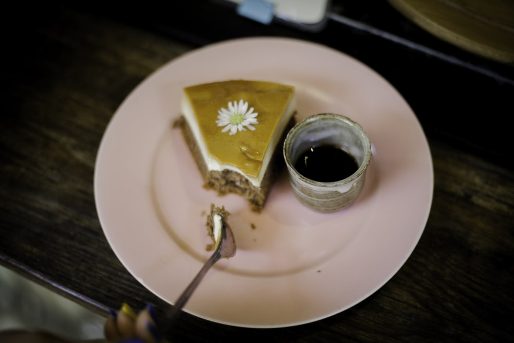 white ceramic cup and pie on plate