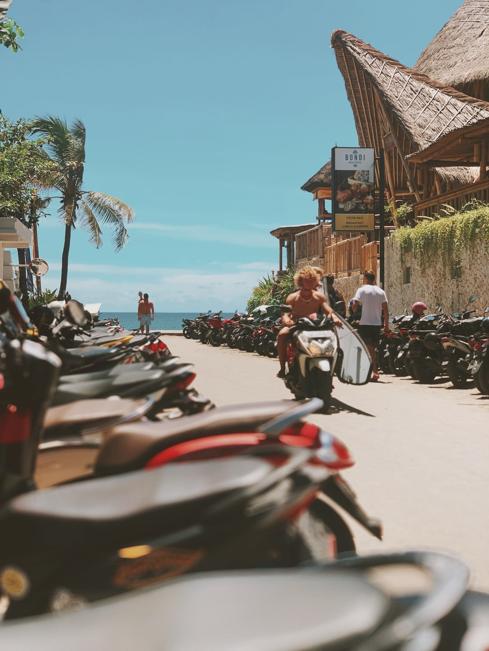 parked motorcycles near beach