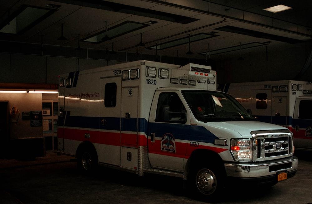 white Ambulance parked in garage