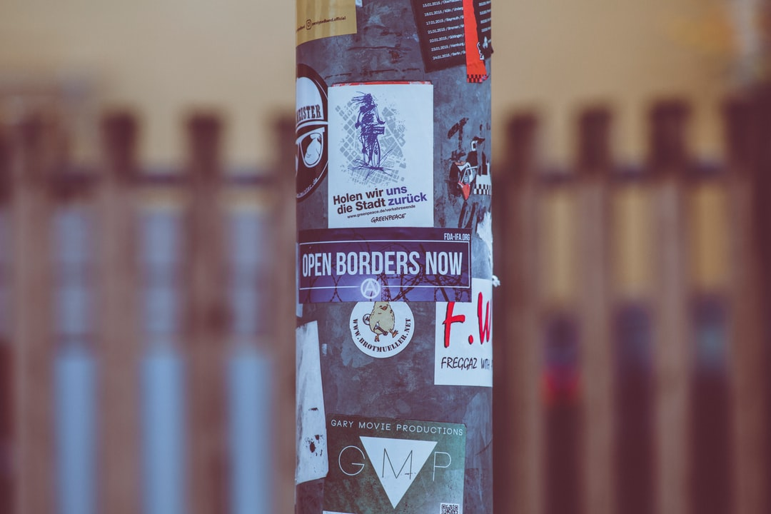 Urban street art sticker OPEN BORDERS NOW. Made with Canon 5d Mark III and analog vintage lens, Leica Elmarit-R 2.8 135mm (Year: 1987)