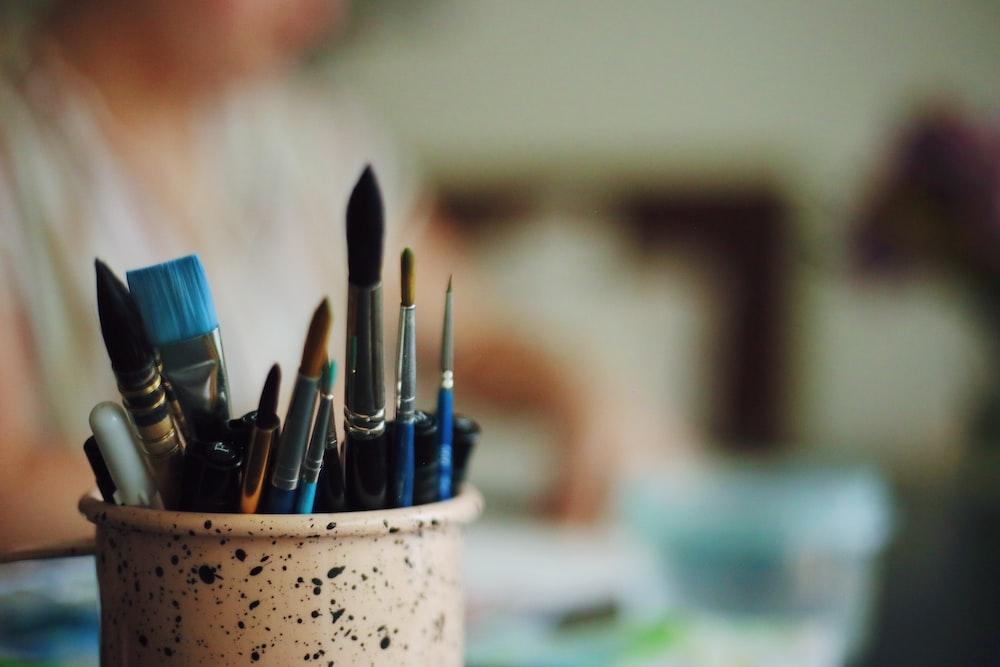 blue hair brushes in vase