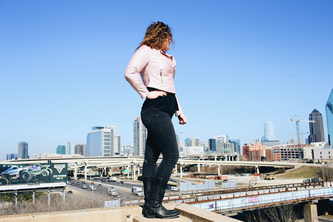 woman standing over city skyline