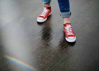 person wearing red Converse All-Star low-top sneakers