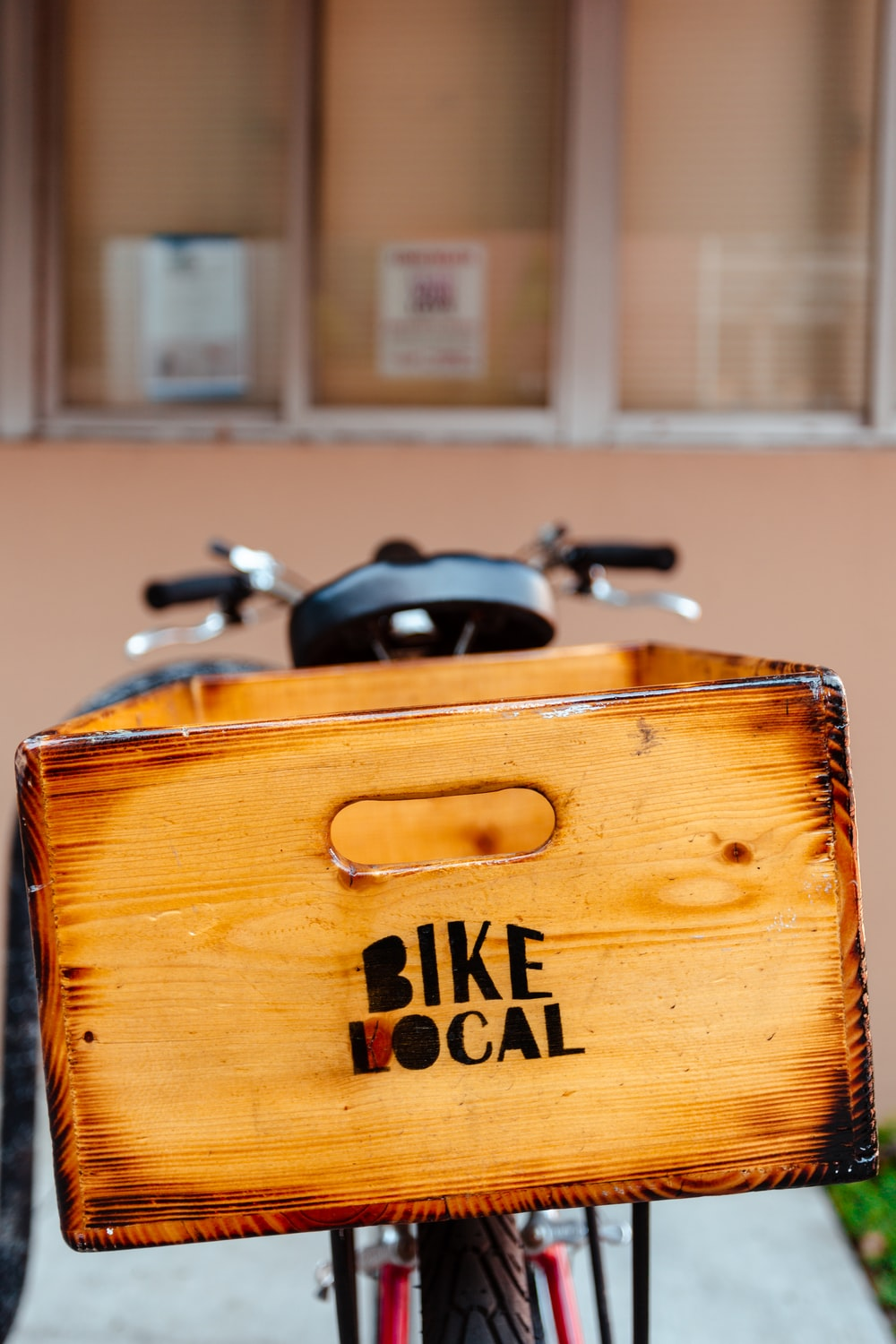 selective focus photography of brown wooden Bike Local box on bike