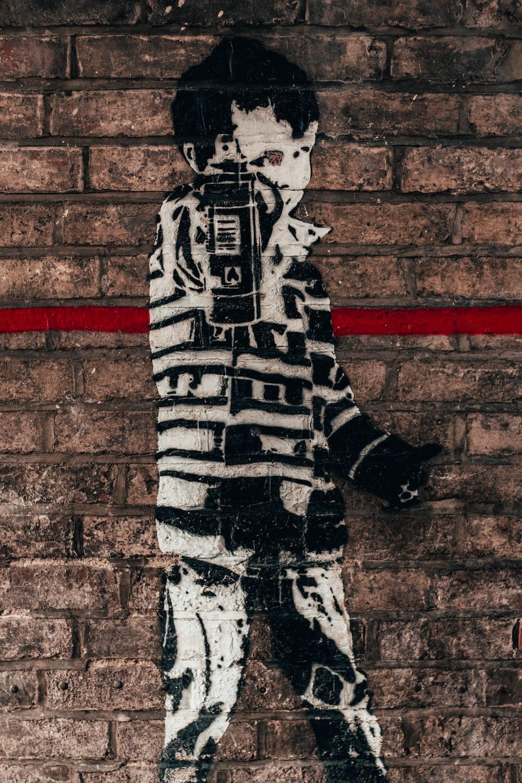 boy holding spray bottle graffiti
