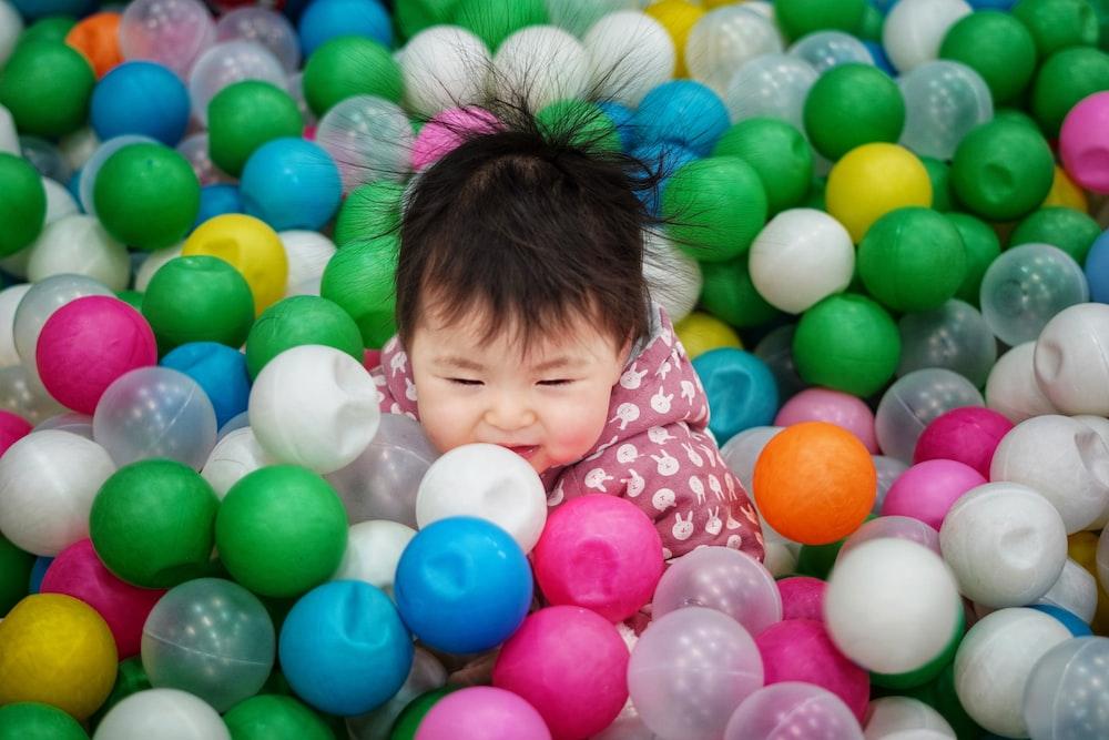 toddler on ball pool