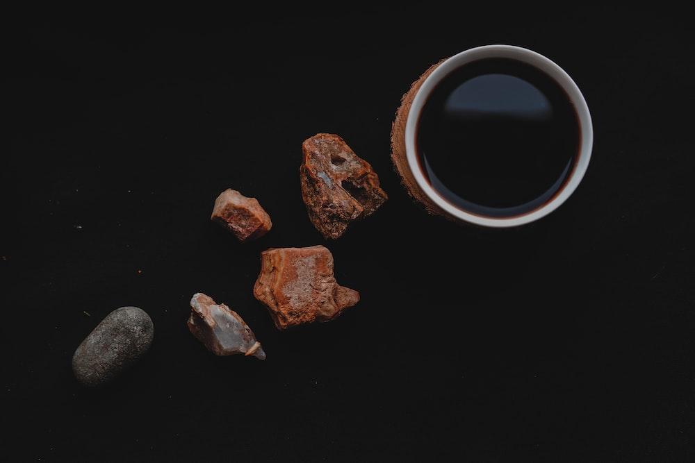 several stones beside white bowl