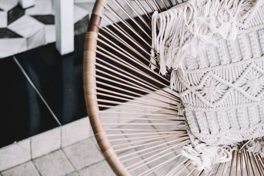 gray fringe knit apparel on brown basket