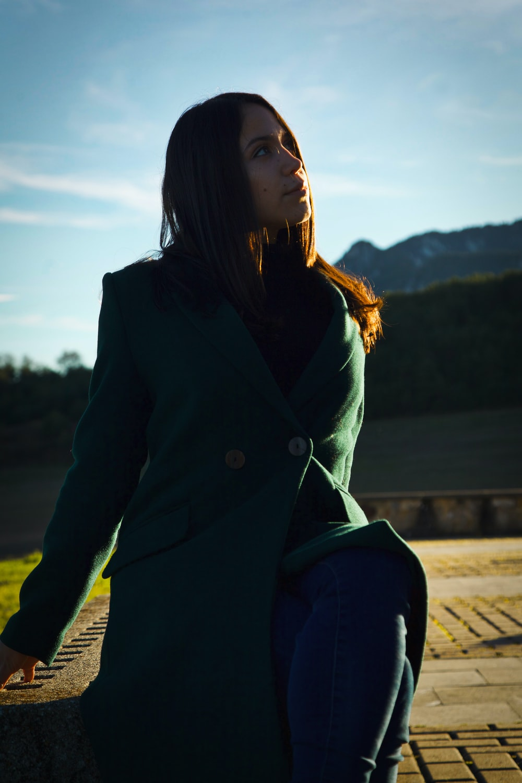 woman wearing green coat