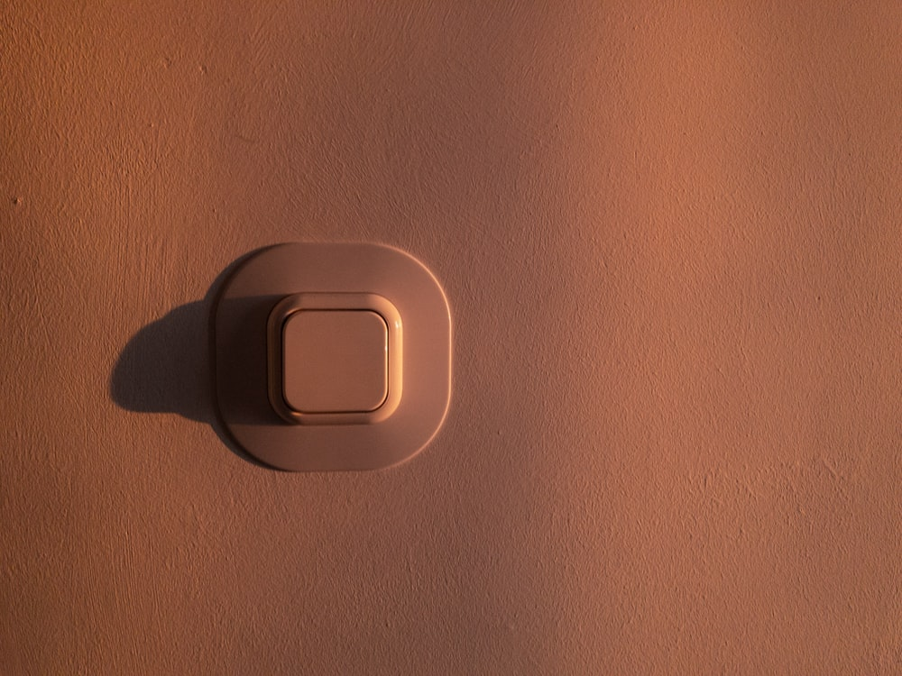 white button on wall