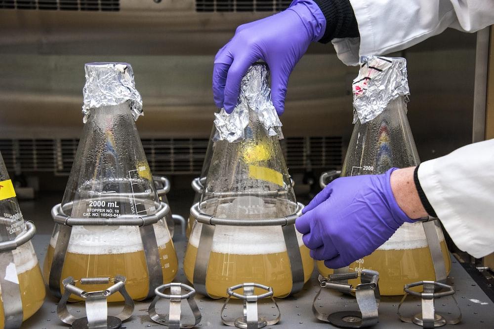 three clear glass laboratory apparatus