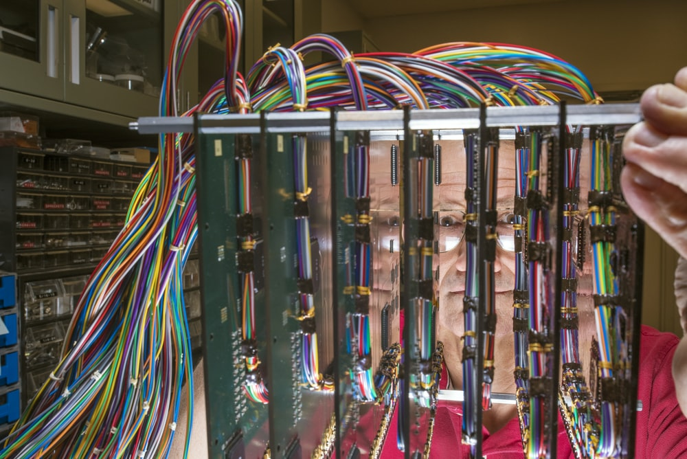 green and multicolored electrical part