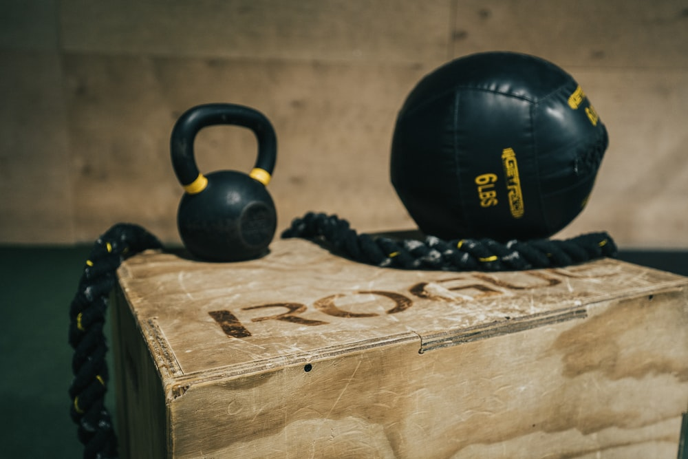 black metal kettle bell and heavy bag