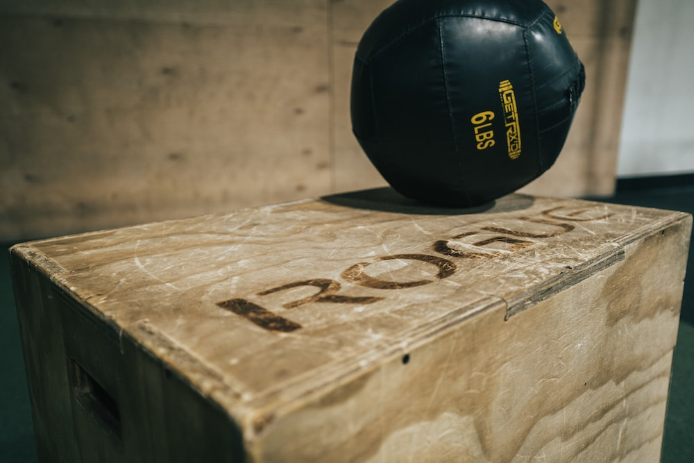 black leather ball on brown wooden table