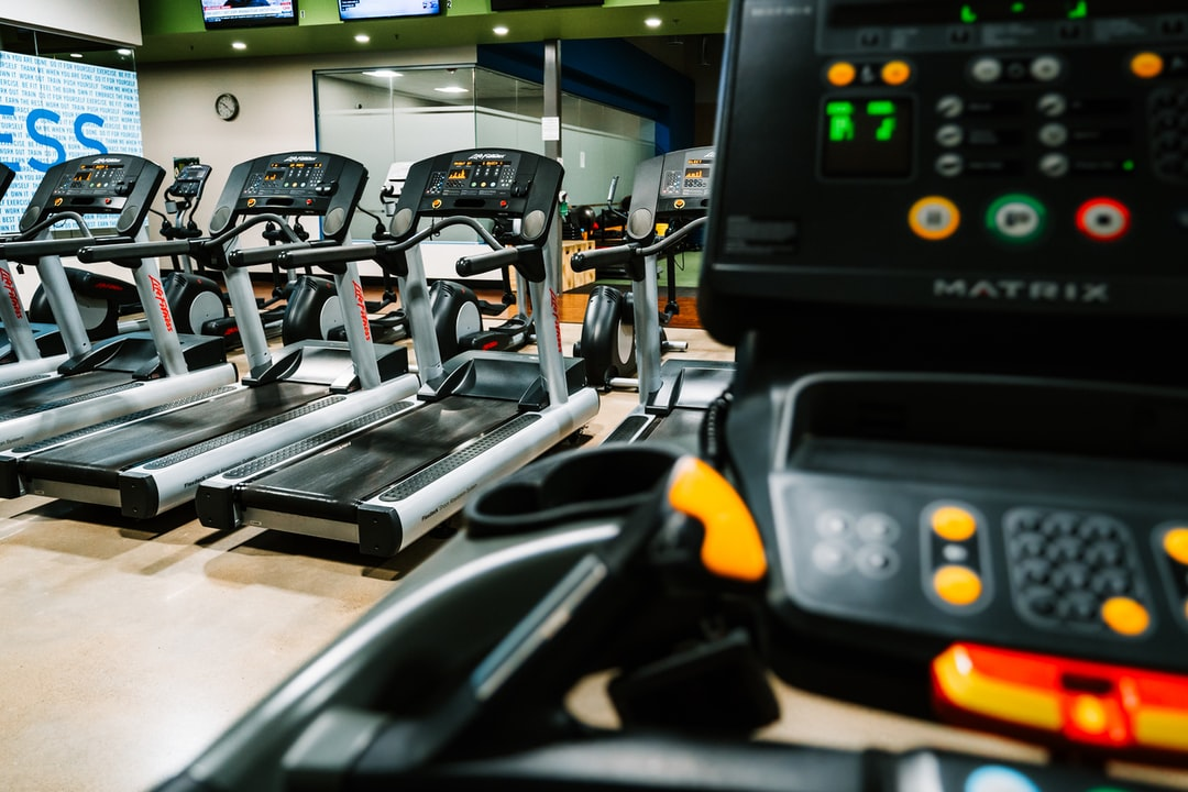 Runner on treadmill in an empty gym