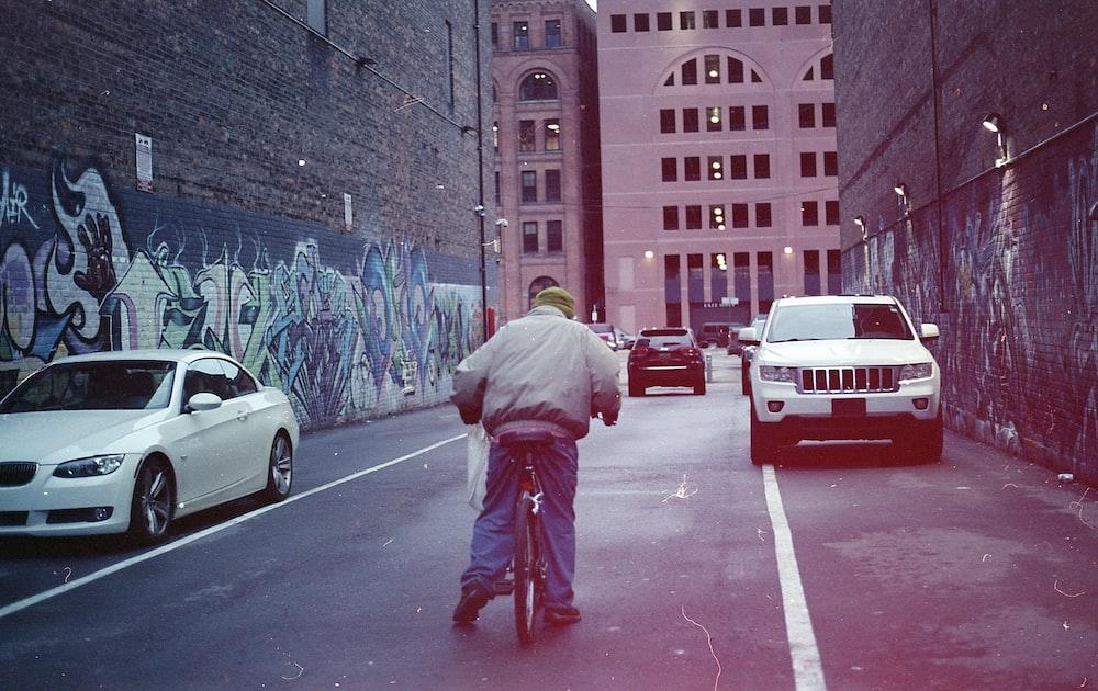 man riding bike on street