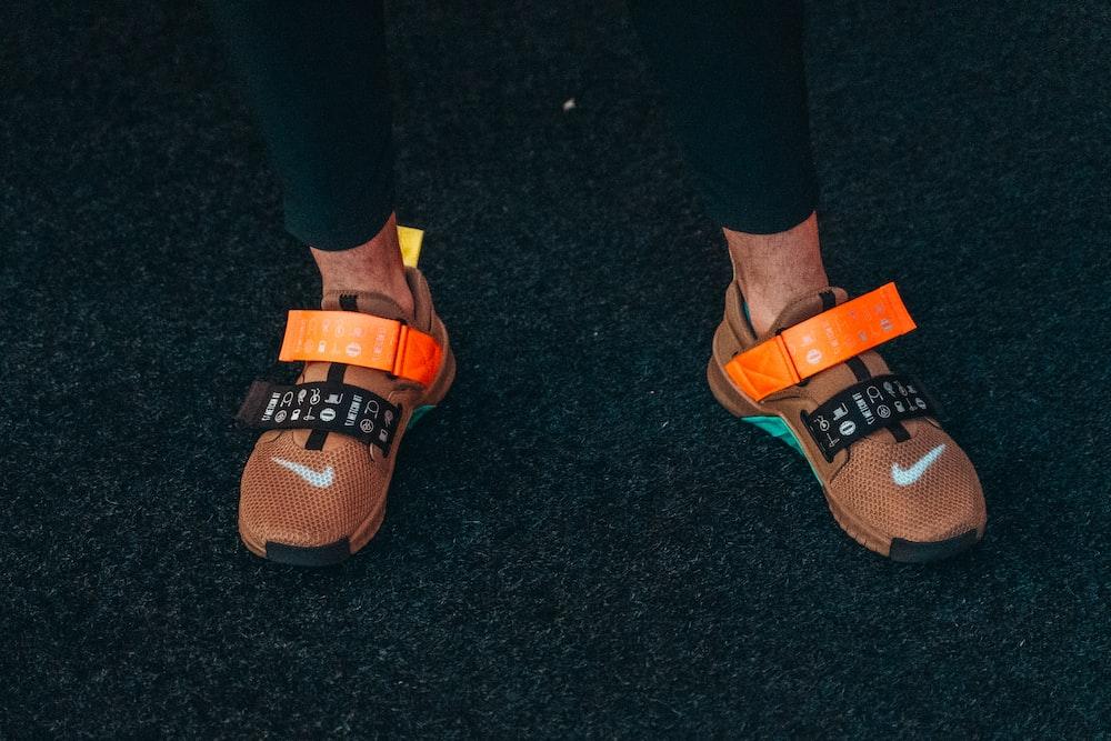pair of orange Nike athletic shoes