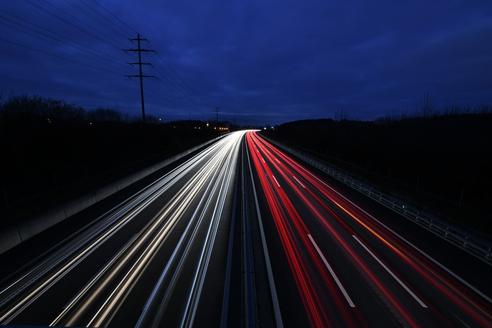 time lapse photography of vehicles travelling on road