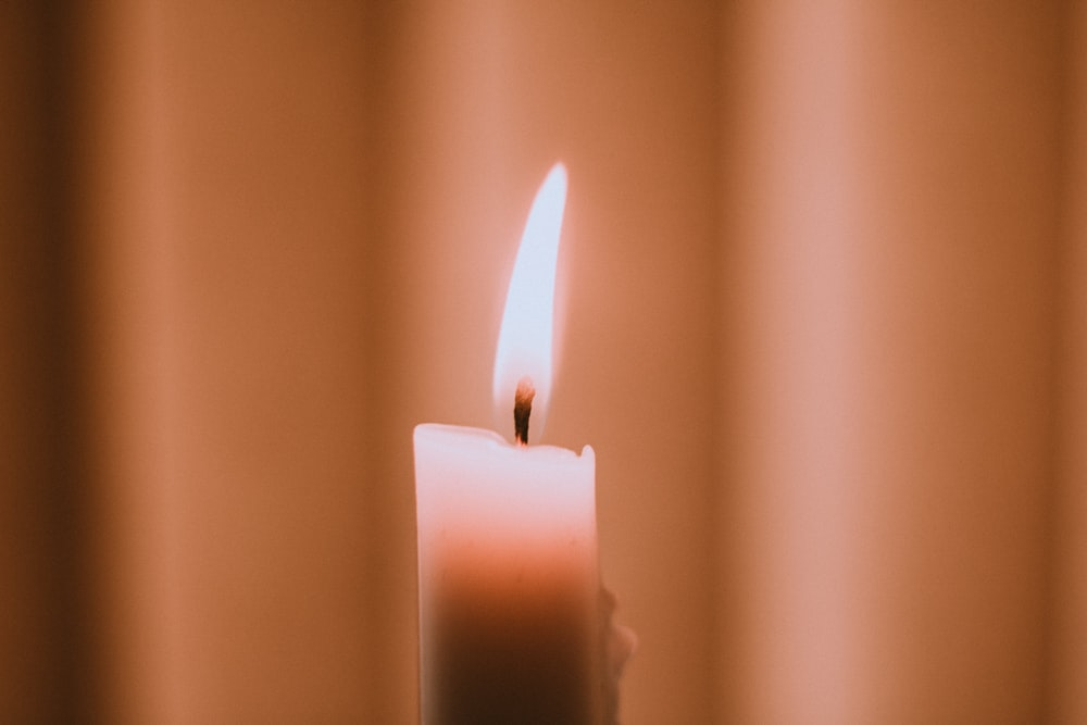 lightened white candle