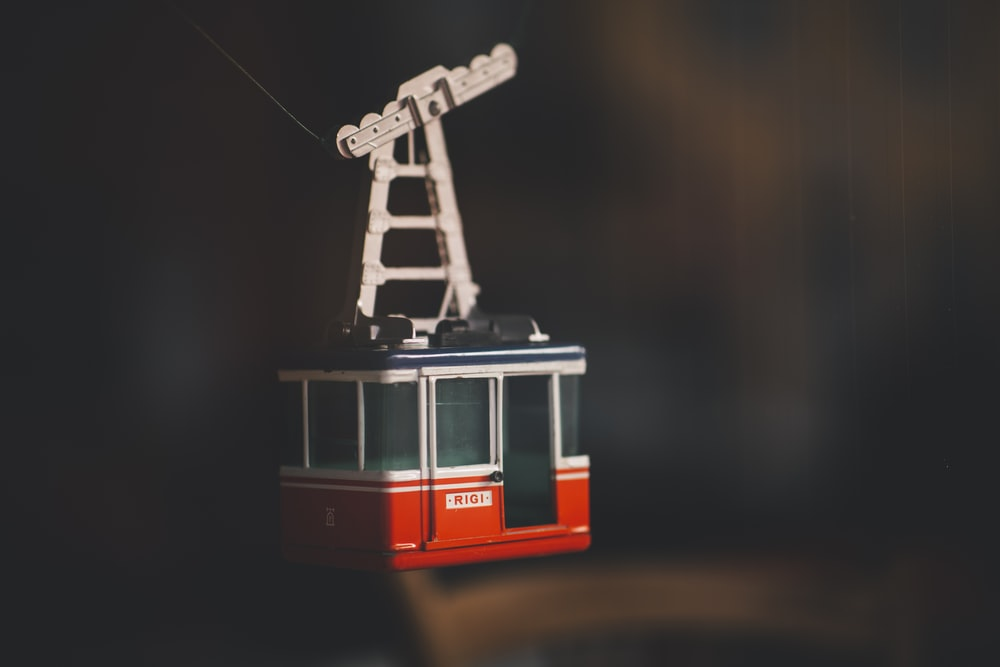 red and white cable cart scale model