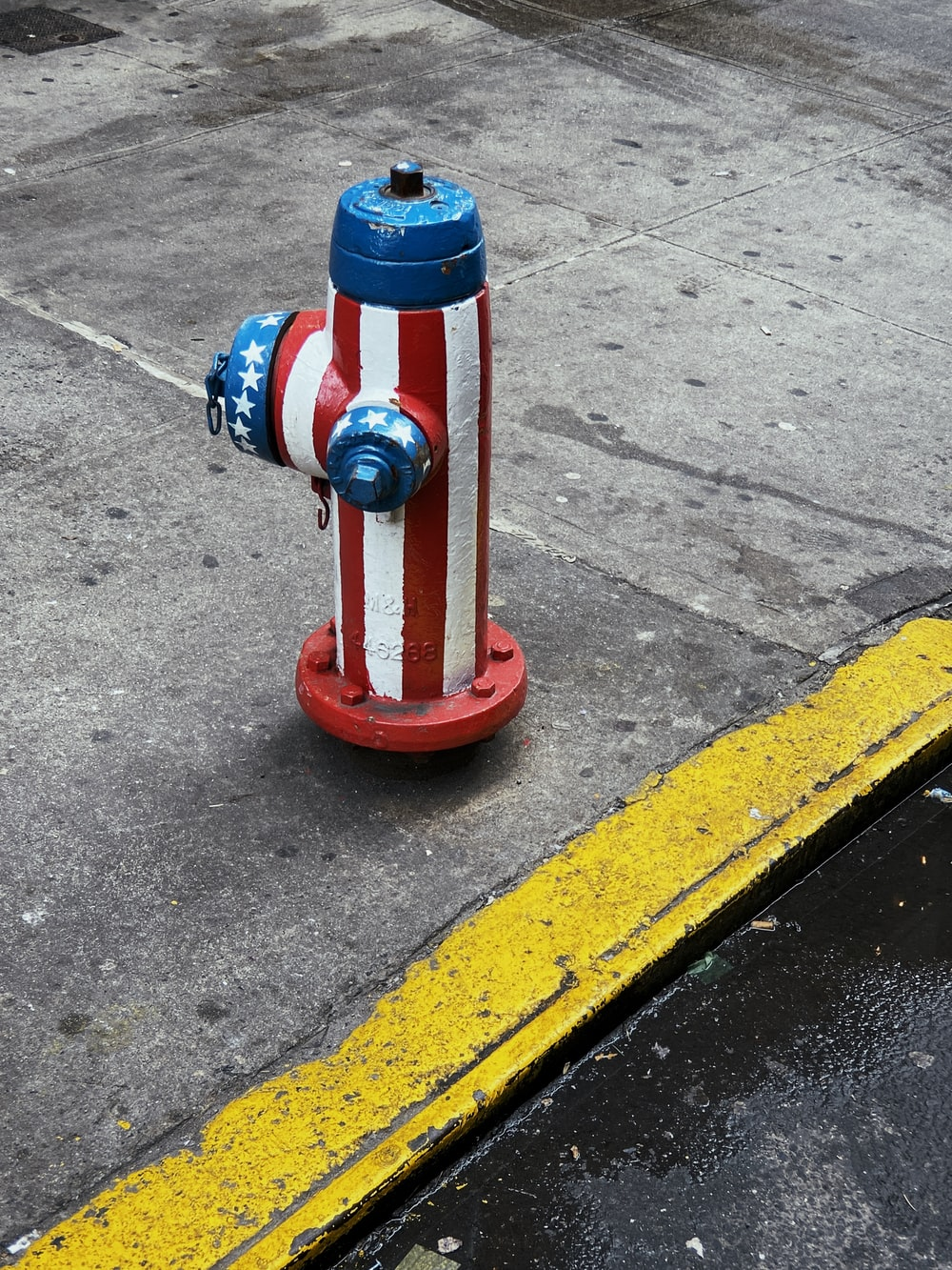 red, white, and blue fire hydrant