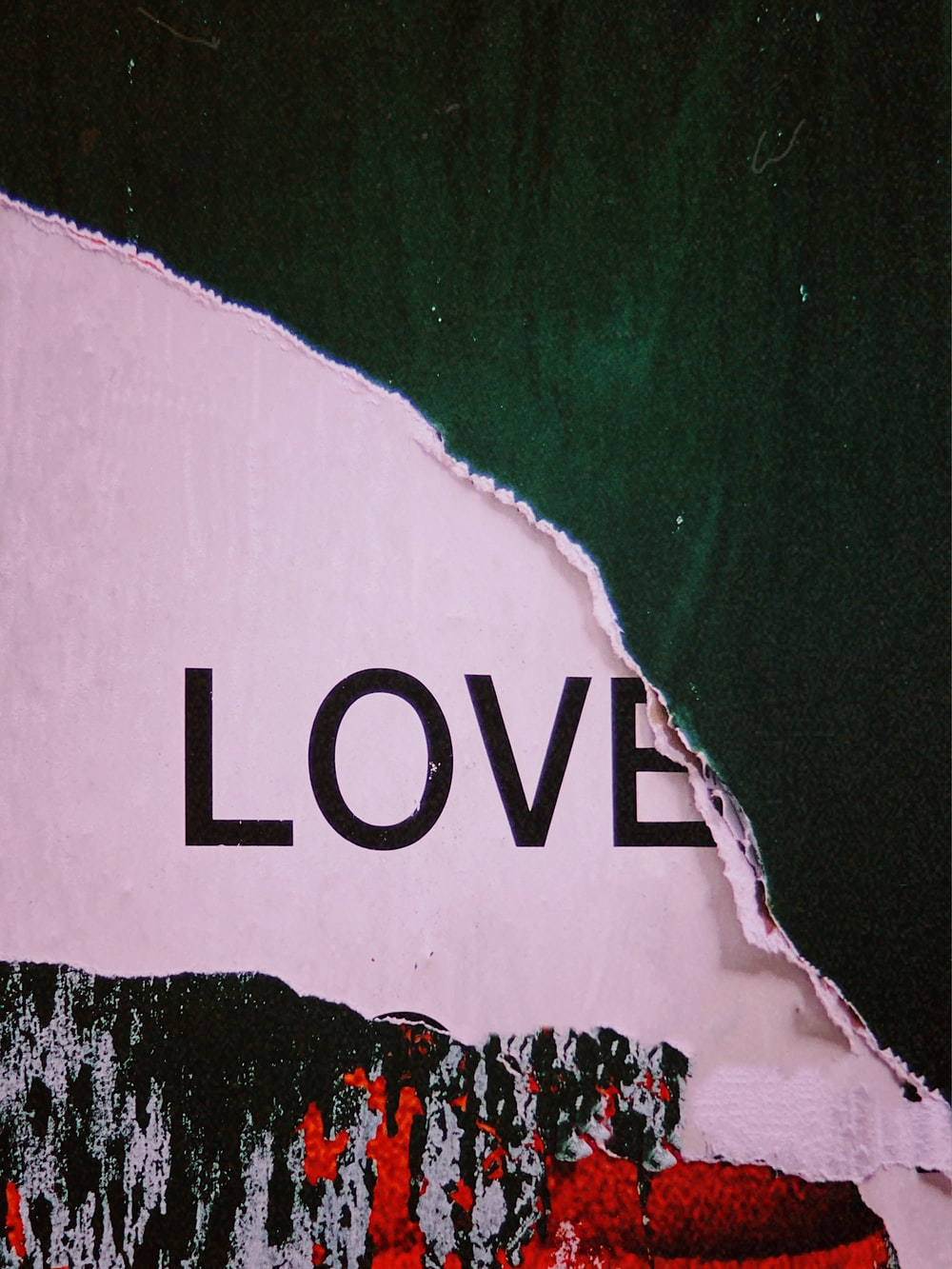 love text under green and red paper